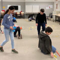 Students at the IMC Weekendschool in Amsterdam lay out tracks for a robot.