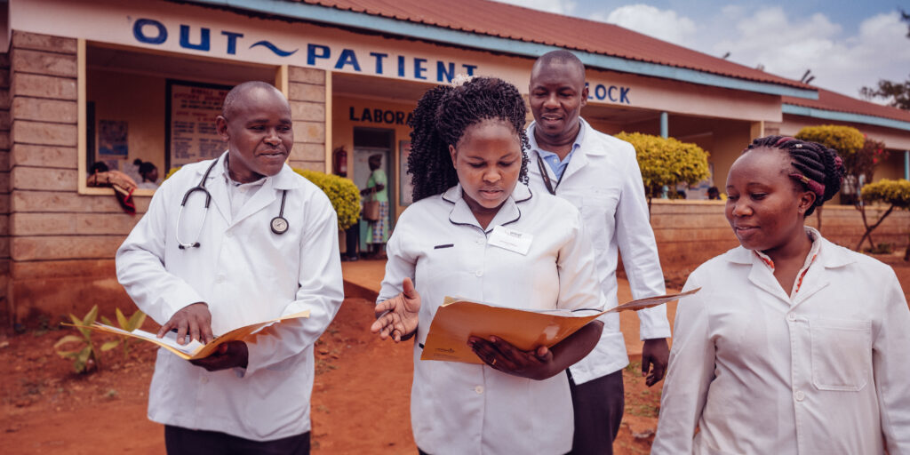 Amref health workers in front of hospital - Leap program